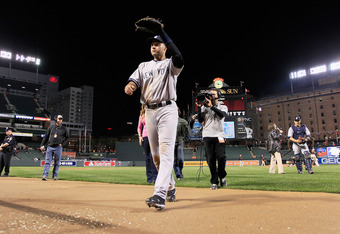 BALTIMORE, MD - APRIL 09:  Derek Jeter #2 of the New York Yankees waves to the crowd after the  Yankees 6-2 win over the Baltimore Orioles at Oriole Park at Camden Yards on April 9, 2012 in Baltimore, Maryland.  (Photo by Rob Carr/Getty Images)