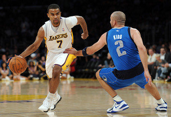 LOS ANGELES, CA - APRIL 15:  Ramon Sessions #7 of the Los Angeles Lakers dribbles by Jason Kidd #2 of the Dallas Mavericks during a 112-108 Laker win at Staples Center on April 15, 2012 in Los Angeles, California.  NOTE TO USER: User expressly acknowledge