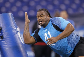 INDIANAPOLIS, IN - FEBRUARY 27: Defensive lineman Dontari Poe of Memphis takes part in a drill during the 2012 NFL Combine at Lucas Oil Stadium on February 27, 2012 in Indianapolis, Indiana. (Photo by Joe Robbins/Getty Images)