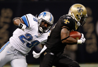 NEW ORLEANS, LA - DECEMBER 04:  Running back Maurice Morris #28 of the Detroit Lions looks to tackle cornerback Tracy Porter #22 of the New Orleans Saints after intercepting a pass in the fourth quarter at Mercedes-Benz Superdome on December 4, 2011 in Ne