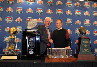 NEW ORLEANS, LA - JANUARY 10:  Mal Moore the Athletic Director of the University of Alabama and Head coach Nick Saban of the Alabama Crimson Tide stand next to all the trophies awarded to Alabama as the national champion after defeating Louisiana State Un