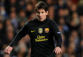 LONDON, ENGLAND - APRIL 18:  Lionel Messi of Barcelona runs with the ball during the UEFA Champions League Semi Final first leg match between Chelsea and Barcelona at Stamford Bridge on April 18, 2012 in London, England.  (Photo by Michael Regan/Getty Ima