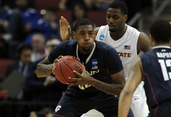 LOUISVILLE, KY - MARCH 15:  Roscoe Smith #22 of the Connecticut Huskies looks to pass in the seocnd half against Melvin Ejim #3 of the Iowa State Cyclones during the second round of the 2012 NCAA Men's Basketball Tournament at KFC YUM! Center on March 15,