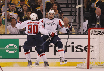 BOSTON, MA - APRIL 21:  Troy Brouwer #20 of the Washington Capitals celebrates his game winning powerplay goal at 18:33 along with Marcus Johansson #90 against the Boston Bruins in Game Five of the Eastern Conference Quarterfinals during the 2012 NHL Stan