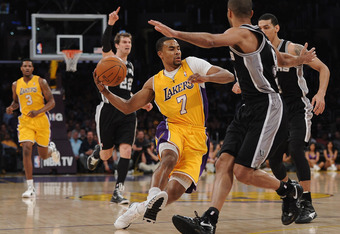 LOS ANGELES, CA - APRIL 17:  Ramon Sessions #7 of the Los Angeles Lakers dribbles the ball in front of Tony Parker #9 of the San Antonio Spurs during the game at Staples Center on April 17, 2012 in Los Angeles, California.  NOTE TO USER: User expressly ac