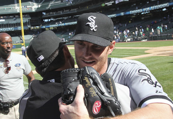 SEATTLE, WA - APRIL 21:  Starting pitcher Philip Humber #41 (R) of the Chicago White Sox is congratulated after throwing a perfect game against the Seattle Mariners at Safeco Field on April 21, 2012 in Seattle, Washington. This was the 21st perfect game i