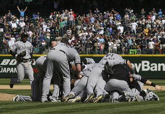 SEATTLE, WA - APRIL 21:  Starting pitcher Philip Humber #41 of the Chicago White Sox is mobbed by teammates after throwing a perfect game against the Seattle Mariners at Safeco Field on April 21, 2012 in Seattle, Washington. This was the 21st perfect game
