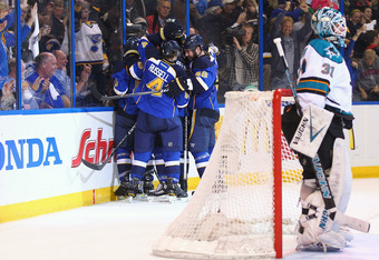 ST. LOUIS, MO - APRIL 21: Members of the St. Louis Blues celebrate their game-tying goal against Antti Niemi #31 of the San Jose Sharks during Game Five of the Western Conference Quarterfinals during the 2012 NHL Stanley Cup Playoffs at the Scottrade Cent