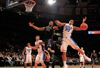 NEW YORK, NY - DECEMBER 10: Desmond Simmons #30 of the Washington Huskies and Andre Dawkins #20 of the Duke Blue Devils battle for a rebound at Madison Square Garden on December 10, 2011 in New York City.  (Photo by Chris Trotman/Getty Images)