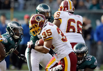 PHILADELPHIA, PA - JANUARY 01:  Evan Royster #35 of the Washington Redskins is tackled by Akeem Jordan #56 of the Philadelphia Eagles at Lincoln Financial Field on January 1, 2012 in Philadelphia, Pennsylvania.  (Photo by Rob Carr/Getty Images)
