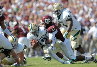 COLLEGE STATION, TX - OCTOBER 15:  Robert Griffin III #10 of the Baylor Bears takes a sack during a game against the Texas A&M Aggies at Kyle Field on October 15, 2011 in College Station, Texas. The Texas A&M Aggies defeated the Baylor Bears 55-28.  (Phot