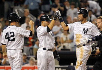 NEW YORK, NY - APRIL 15:  Derek Jeter of the New York Yankees celebrates with scoring runners Brett Gardner and Russell Martin after hitting a three run home run in the fourth inning against the Los Angeles Angels of Anaheim at Yankee Stadium on April 15,