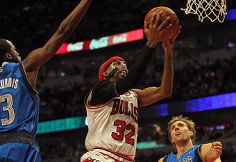CHICAGO, IL - APRIL 21: Richard Hamilton #32 of the Chicago Bulls drives to the basket between Rodrigue Baeubois #3 and Dirk Nowitzki #41 of the Dallas Mavericks at the United Center on April 21, 2012 in Chicago, Illinois. The Bulls defeated the Mavericks