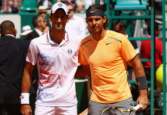 MONTE-CARLO, MONACO - APRIL 22:  Novak Djokovic of Serbia poses for a photograph with Rafael Nadal of Spain prior the final during day eight of the ATP Monte Carlo Masters, at Monte-Carlo Sporting Club on April 22, 2012 in Monte-Carlo, Monaco..  (Photo by