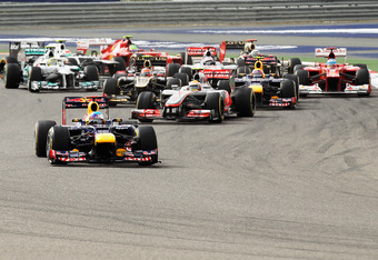 SAKHIR, BAHRAIN - APRIL 22:  Sebastian Vettel of Germany and Red Bull Racing leads the field at the start of the Bahrain Formula One Grand Prix at the Bahrain International Circuit on April 22, 2012 in Sakhir, Bahrain.  (Photo by Mark Thompson/Getty Image