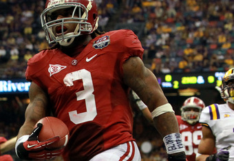 NEW ORLEANS, LA - JANUARY 09:  Trent Richardson #3 of the Alabama Crimson Tide celebrates after scoring a touchdown in the fourth quarter against the Louisiana State University Tigers during the 2012 Allstate BCS National Championship Game at Mercedes-Ben