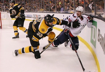 BOSTON, MA - APRIL 21: Zdeno Chara #33 of the Boston Bruins hits Marcus Johansson #90 of the Washington Capitals in Game Five of the Eastern Conference Quarterfinals during the 2012 NHL Stanley Cup Playoffs at TD Garden on April 21, 2012 in Boston, Massac