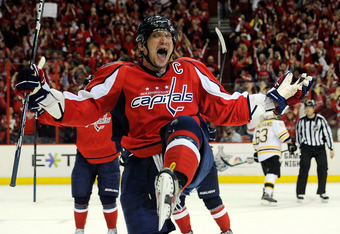 WASHINGTON, DC - APRIL 22:  Alex Ovechkin #8 of the Washington Capitals celebrates after scoring a goal in the third period against the Boston Bruins in Game Six of the Eastern Conference Quarterfinals during the 2012 NHL Stanley Cup Playoffs at Verizon C