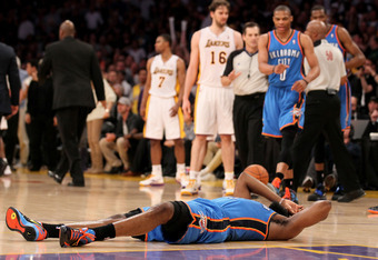 LOS ANGELES, CA - APRIL 22:  James Harden #13 of the Oklahoma City Thunder lies on the floor after being hit by Metta World Peace #15 of the Los Angeles Lakers as referees separate Thunder and Lakers players at Staples Center on April 22, 2012 in Los Ange