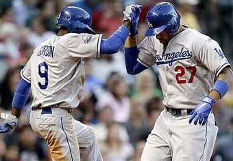 Kemp celebrates his ninth home run of the season with teammate Dee Gordon.