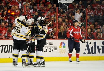 WASHINGTON, DC - APRIL 22:  Rich Peverley #49 of the Boston Bruins celebrates with his teammates after scoring a goal against the Washington Capitals in Game Six of the Eastern Conference Quarterfinals during the 2012 NHL Stanley Cup Playoffs at Verizon C