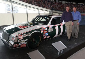 CHARLOTTE, NC - MARCH 22:  Darrell Waltrip (L) stands with Winston Kelly (R) and his Championship-winning No. 11 Mountain Dew Buick during the kick off of the final 50 days before the opening of the NASCAR Hall of Fame at the NASCAR Hall of Fame on March