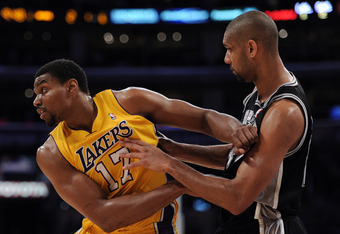 LOS ANGELES, CA - APRIL 17:  Andrew Bynum #17 of the Los Angeles Lakers attempts gets in position as he is watched by Tim Duncan #21 of the San Antonio Spurs at Staples Center on April 17, 2012 in Los Angeles, California.  NOTE TO USER: User expressly ack
