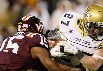 ATLANTA, GA - NOVEMBER 10:  Preston Lyons #27 of the Georgia Tech Yellow Jackets rushes away from Eddie Whitley #15 of the Virginia Tech Hokies at Bobby Dodd Stadium on November 10, 2011 in Atlanta, Georgia.  (Photo by Kevin C. Cox/Getty Images)
