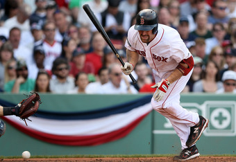 BOSTON, MA - APRIL 21:  Kevin Youkilis #20 of the Boston Red Sox is hit by a pitch in the third inning against the New York Yankees  on April 21, 2012 at Fenway Park in Boston, Massachusetts.  (Photo by Elsa/Getty Images)