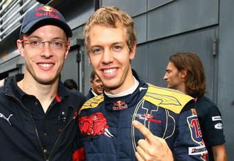 Sebastien Vettel on right, Sebastien Bourdais (l)