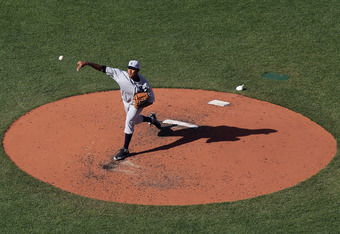 BOSTON, MA - APRIL 20:  Ivan Nova #47 of the New York Yankees delivers a pitch against the Boston Red Sox on April 20, 2012 at Fenway Park in Boston, Massachusetts. Today marks the 100 year anniversary of the ball park's opening. The New York Yankees defe