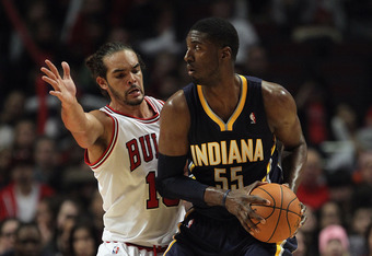 CHICAGO, IL - DECEMBER 20: Roy Hibbert #55 of the Indiana Pacers looks to pass under presure from Joakim Noah #13 of the Chicago Bulls at the United Center on December 20, 2011 in Chicago, Illinois. The Bulls defeated the Pacers 93-85. NOTE TO USER: User