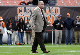 CLEVELAND, OH - OCTOBER 2:  Cleveland Browns president Mike Holmgren greets people on the field prior to to the game between the Cleveland Browns and the Tennessee Titans at Cleveland Browns Stadium on October 2, 2011 in Cleveland, Ohio. (Photo by Jason M