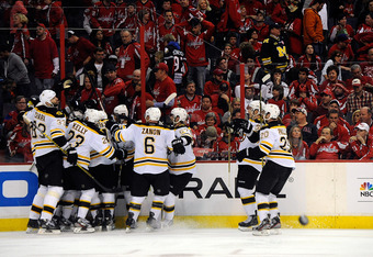 WASHINGTON, DC - APRIL 22:  The Boston Bruins celebrate after Tyler Seguin #19 scored the game winning goal in overtime against the Washington Capitals in Game Six of the Eastern Conference Quarterfinals during the 2012 NHL Stanley Cup Playoffs at Verizon