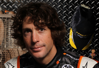 DAYTONA BEACH, FL - FEBRUARY 16:  Travis Pastrana, driver of the #99 Boost Mobile Toyota, poses during NASCAR Media Day at Daytona International Speedway on February 16, 2012 in Daytona Beach, Florida.  (Photo by Jamie Squire/Getty Images for NASCAR)