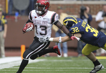 ANN ARBOR, MI - SEPTEMBER 24: Ronnie Hillman #13 of San Diego State runs for a first down as Jordan Kovacs #32 of the Michigan Wolverines attempts to make the stop runs during the first half of the game at Michigan Stadium on September 24, 2011 in Ann Arb
