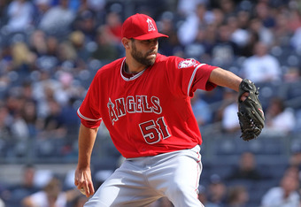 NEW YORK, NY - APRIL 14:  Jordan Walden #51 of the Los Angeles Angels of Anaheim pitches against the New York Yankees  at Yankee Stadium on April 14, 2012 in the Bronx borough of New York City.  (Photo by Nick Laham/Getty Images)