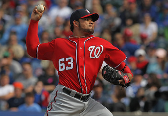 CHICAGO, IL - APRIL 07:  Henry Rodriguez #63 of the Washington Nationals picks up a save against the Chicago Cubs at Wrigley Field on April 7, 2012 in Chicago, Illinois. The Nationals defeated the Cubs 7-4.  (Photo by Jonathan Daniel/Getty Images)