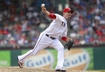 ARLINGTON, TX - APRIL 12: Mike Adams #37 of the Texas Rangers delivers a pitch against the Seattle Mariners at Rangers Ballpark in Arlington on April 12, 2012 in Arlington, Texas. (Photo by Rick Yeatts/Getty Images)
