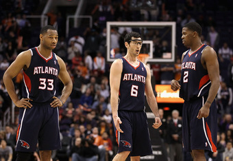 PHOENIX, AZ - FEBRUARY 15:  (L-R) Willie Green #33, Kirk Hinrich #6 and Joe Johnson #2 of the Atlanta Hawks during the NBA game against the Phoenix Suns at US Airways Center on February 15, 2012 in Phoenix, Arizona.  NOTE TO USER: User expressly acknowled