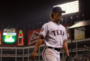 ARLINGTON, TX - APRIL 09:  Yu Darvish #11 of the Texas Rangers leaves the game in the sixth inning against the Seattle Mariners at Rangers Ballpark in Arlington on April 9, 2012 in Arlington, Texas.  (Photo by Ronald Martinez/Getty Images)