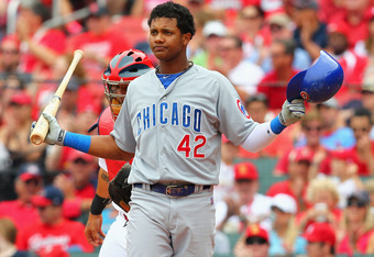 ST. LOUIS, MO - APRIL 15: Starlin Castro of the Chicago Cubs reacts to striking out against the St. Louis Cardinals at Busch Stadium on April 15, 2012 in St. Louis, Missouri.  Both teams wore the number 42 in honor of Jackie Robinson Day.  (Photo by Dilip