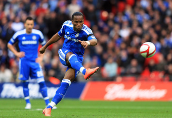 Didier Drogba takes a free kick against Spurs in the FA Cup semifinals as John Terry looks on.