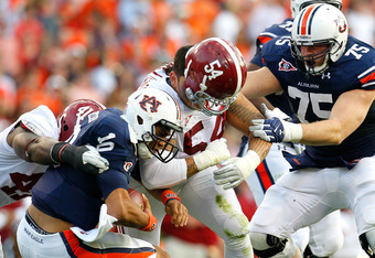 AUBURN, AL - NOVEMBER 26:  Kiehl Frazier #10 of the Auburn Tigers is sacked by Courtney Upshaw #41 and Jesse Williams #54 of the Alabama Crimson Tide at Jordan-Hare Stadium on November 26, 2011 in Auburn, Alabama.  (Photo by Kevin C. Cox/Getty Images)