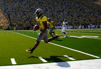 EUGENE, OR - SEPTEMBER 10:  LaMichael James #21 of the Oregon Ducks scores a touchdonw on a pass in the second quarter against the Nevada Wolf Pack on September 10, 2011 at the Autzen Stadium in Eugene, Oregon.  (Photo by Jonathan Ferrey/Getty Images)