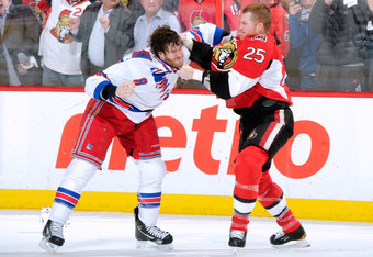 OTTAWA, CANADA - APRIL 23:  Chris Neil #25 of the Ottawa Senators and Brandon Prust #8 of the New York Rangers fight in Game Six of the Eastern Conference Quarterfinals during the 2012 NHL Stanley Cup Playoffs at the Scotiabank Place on April 23, 2012 in