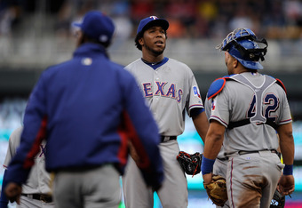 MINNEAPOLIS, MN - APRIL 15: Ron Washington #38 of the Texas Rangers walks to the mound to relieve starting pitcher Neftali Feliz as catcher Yorvit Torrealba looks on on April 15, 2012 at Target Field in Minneapolis, Minnesota. The Texas Rangers wore the n