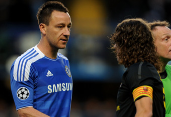 LONDON, ENGLAND - APRIL 18:  (L-R) John Terry of Chelsea shakes hands with Carles Puyol of Barcelona prior to kickoff during the UEFA Champions League Semi Final first leg match between Chelsea and Barcelona at Stamford Bridge on April 18, 2012 in London,