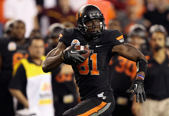 GLENDALE, AZ - JANUARY 02:  Justin Blackmon #81 of the Oklahoma State Cowboys runs for yards after the catch against the Stanford Cardinal during the Tostitos Fiesta Bowl on January 2, 2012 at University of Phoenix Stadium in Glendale, Arizona.  (Photo by