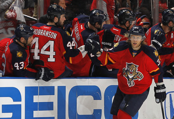 SUNRISE, FL - APRIL 21: Kris Versteeg #32 of the Florida Panthers is congratulated by teammates after scoring a second period goal against the New Jersey Devils in Game Five of the Eastern Conference Quarterfinals during the 2012 NHL Stanley Cup Playoffs